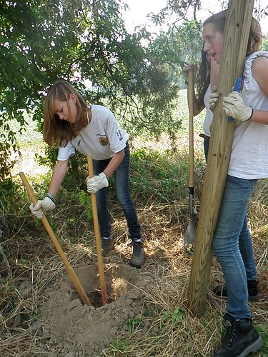 Digging Fence Post Holes by Hand - Sawyer Ventures LLC