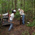Using shovel and digging bar for post holes